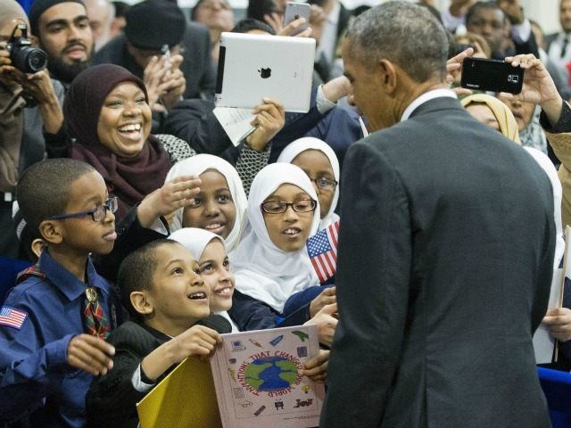 President Barack Obama stops to greets children from Al-Rahmah school and other guests during his visit to the Islamic Society of Baltimore, Wednesday, Feb. 3, 2016, in Baltimore, Md. Obama is making his first visit to a U.S. mosque at a time Muslim-Americans say they're confronting increasing levels of bias in speech and deeds.(