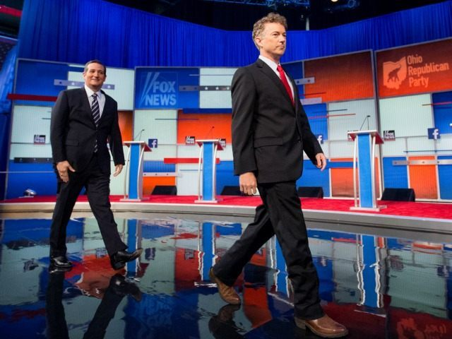 Sen. Ted Cruz, R-Texas, and Sen. Rand Paul, R-Ky., take the stage for the first Republican presidential debate Thursday, Aug. 6, 2015, in Cleveland.