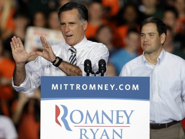 Mitt Romney, accompanied by Sen. Marco Rubio, R-Fl at the University of Miami, Wednesday, Oct. 31, 2012, in Coral Gables, Fla.