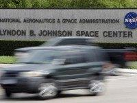Cars pass by NASA's Johnson Space Center Tuesday, Oct. 1, 2013, in Houston. Most of the space center's employees are now on furlough because of the partial government shutdown. Those working to support the international space station continue to work. Congress plunged the nation into a partial government shutdown Tuesday …