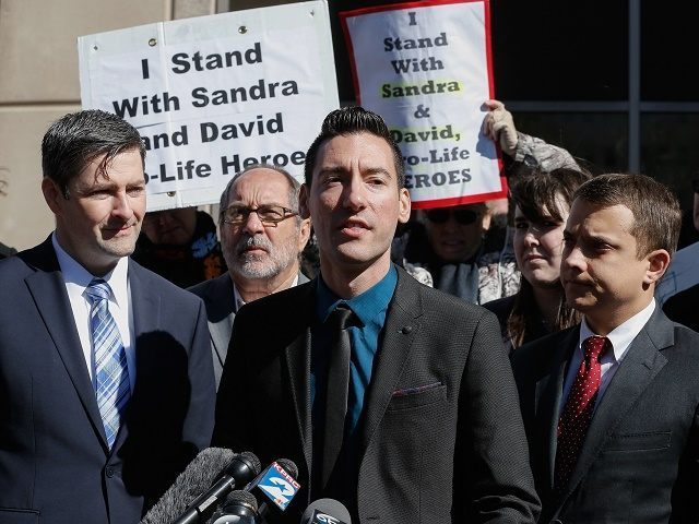 David Daleiden, one of the two anti-abortion activists indicted last week, speaks to supporters outside the Harris County Criminal Courthouse after turning himself in to authorities Thursday, Feb. 4, 2016, in Houston. Daleiden and Sandra Merritt are charged with tampering with a governmental record, a felony punishable by up to …
