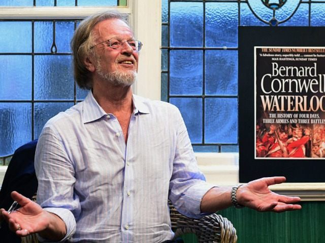 Bernard Cornwell speaks with fans as he signs books at an engagement to promote his first book of non-fiction 'Waterloo: The History of Four Days, Three Armies and Three Battles' at a bookshop in London on June 16, 2015. Cornwell, best known for his popular historical novels featuring the adventures …