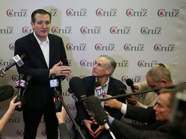 Texas Governor, Greg Abbott, (R) listens as Sen. Ted Cruz (R-TX) speaks on February 24, 2016 in Houston, Texas.