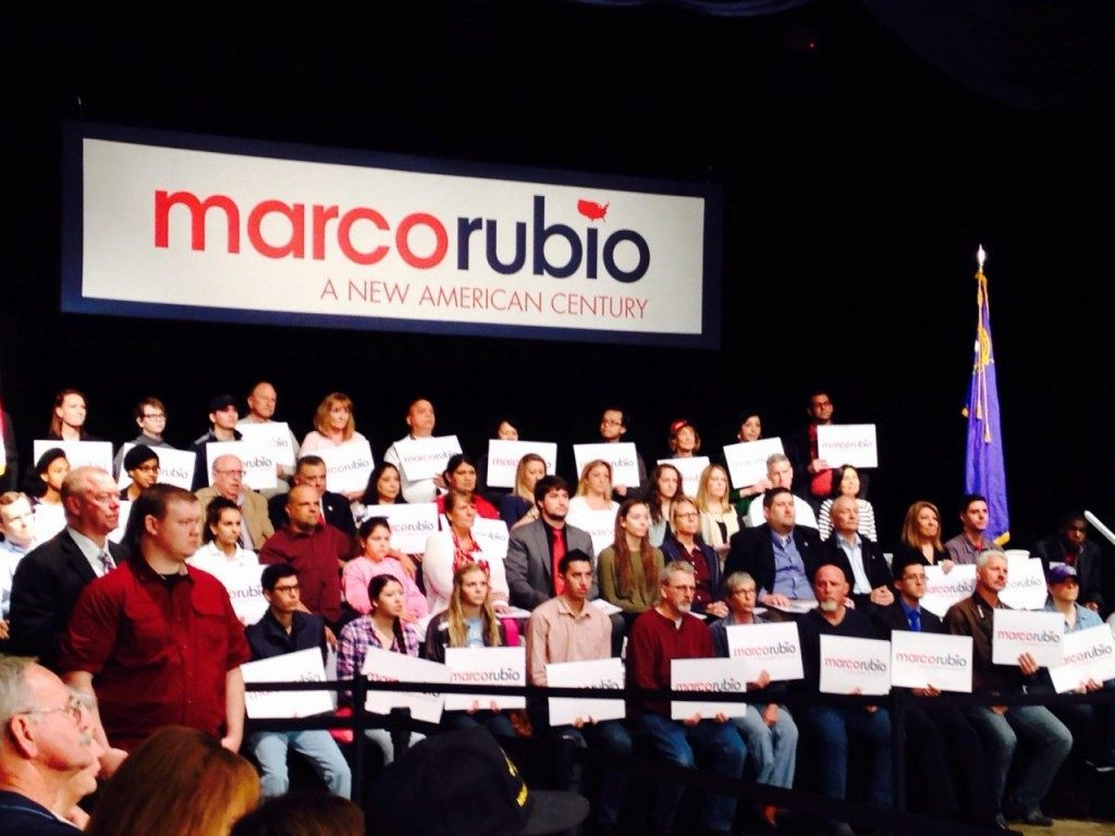 Diverse array of ethnicities on stage behind Rubio at early morning rally