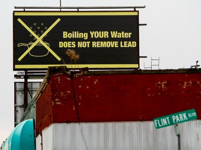 A sign tells Flint residents that boiling water doesn't remove lead on February 7, 2016 in Flint, Michigan.