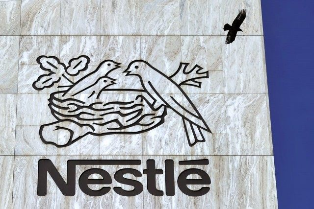 A crow flies above a sign of the world's biggest food company Nestle at their headquarters on August 10, 2011 in Vevey. Nestle posted a 13.7 percent fall in first half net profit to 4.7 billion Swiss francs ($6.5 billion, €4.5 billion), hurt by the strong Swiss franc against most …