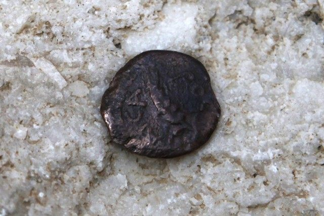 One of the two ancient bronze coins, which according to Israel Antiquities Authority archaeologists were struck by the Roman procurator of Judea, Valerius Gratus, in the year 17/18 CE and recently were revealed in excavations beneath the Western Wall in Jerusalem's Old City