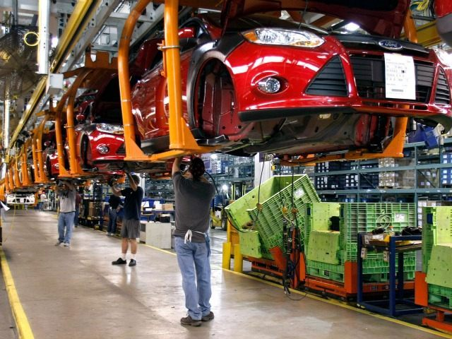 WAYNE, MI - DECEMBER 14: Workers build a Ford Focus on the assembly line at the Ford Motor Co.'s Michigan Assembly Plant December 14, 2011 in Wayne, Michigan. Ford released details about the electrification of the Michigan Assembly Plant that will power production in part by one of the largest …