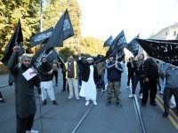 "Norwegian Muslims demonstrate outside the US Embassy in Oslo on September 21, 2012 to protest against the US-made film ""Innosence of Muslims"". Fresh protests erupted across the Muslim world on September 21 against a US-made film and French cartoons mocking Islam, with violent demonstrations in Pakistan leaving at least 13 …"