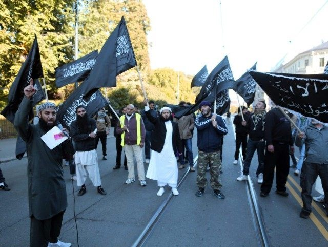 "Norwegian Muslims demonstrate outside the US Embassy in Oslo on September 21, 2012 to protest against the US-made film ""Innosence of Muslims"". Fresh protests erupted across the Muslim world on September 21 against a US-made film and French cartoons mocking Islam, with violent demonstrations in Pakistan leaving at least 13 people dead. In Middle Eastern and Asian countries tens of thousands took to the streets after the main weekly prayers to vent their anger, with little sign that the angry protests which began 11 days ago would abate.   AFP PHOTO / NTB scanpix / Kyrre Lien        (Photo credit should read Lien, Kyrre/AFP/GettyImages)"