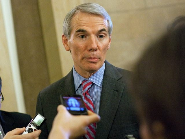 """WASHINGTON, DC - DECEMBER 20: Senator Rob Portman (R-OH) speaks with reporters outside of Speaker John Boehner's office, on Capitol Hill, December 20, 2012 in Washington, DC. House Republicans called off plans to vote on Boehner's """"Plan B"""" Fiscal Cliff plan. (Drew Angerer/Getty Images)"""