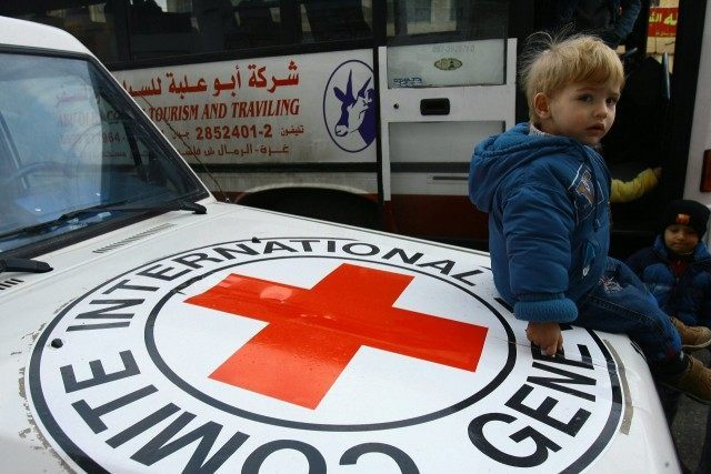 Foreigners and Palestinians with dual nationality gather outside the International Red Cross headquarters in Gaza City on January 8, 2009 as they prepare to leave Gaza.