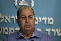 Israeli Defence Minister Moshe Yaalon pauses during a press conference at the prime minister's office in Jerusalem, on August 27, 2014.