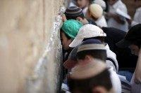 Jewish children pray at the Western Wall in Jerusalem, on May 6, 2015.