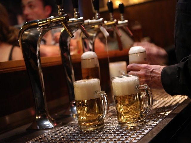 BERLIN, GERMANY - APRIL 22: A bartender serves beers at the Alt Berlin (Old Berlin) bar on April 22, 2014 in Berlin, Germany. The bar, which opened in 1893 and is known for its familial atmosphere, is claimed to be the oldest bar in the German capital, a city with …