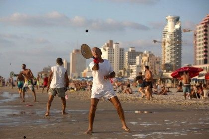 Matkot is the most popular game on Israel's beaches, with fierce, hard-hitting sessions played on the Tel Aviv waterfront and shores across the country. AFP PHOTO/MENAHEM KAHANA (Photo credit should read MENAHEM KAHANA/AFP/Getty Images)