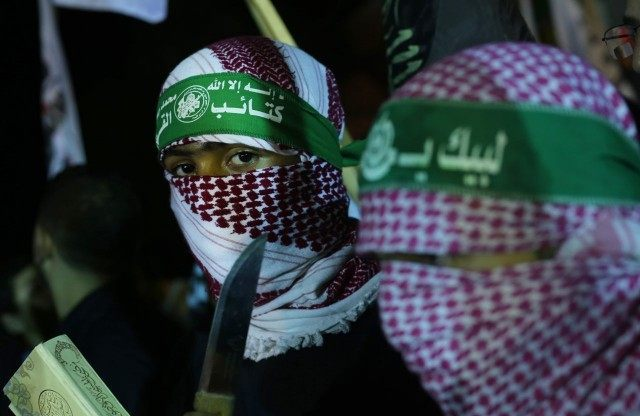 Supporters of the Islamist movement Hamas gather during a rally in support of felllow Palestinians following clashes between Palestinians and Israeli police at Jerusalem's flashpoint Al-Aqsa mosque compound and the West Bank, on October 5, 2015, in Gaza City
