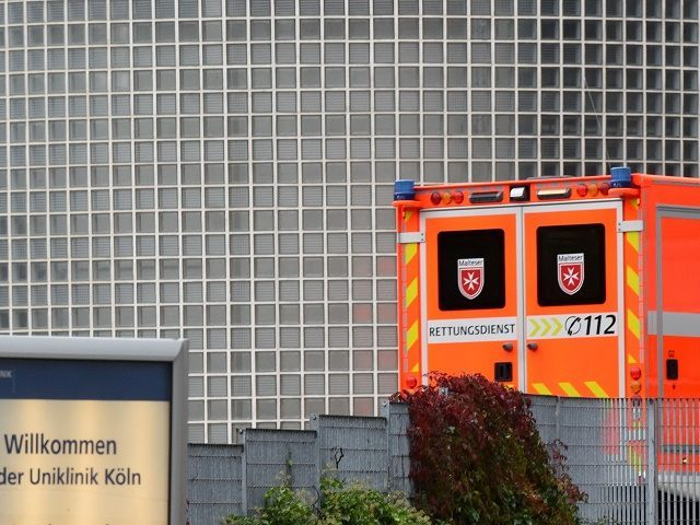 An ambulance arrives at the University Hospital in Cologne, western Germany, where a candidate for mayoral election in Cologne is getting medical treatment after she was attacked on October 17, 2015. The crossbench candidate Henriette Reker was stabbed by a man and seriously injured while canvassing on the eve of …