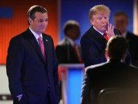 NORTH CHARLESTON, SC - JANUARY 14:  Republican presidential candidates (L-R) Sen. Ted Cruz (R-TX) and Donald Trump speak to the moderators during a commercial break in the Fox Business Network Republican presidential debate at the North Charleston Coliseum and Performing Arts Center on January 14, 2016 in North Charleston, South Carolina. The sixth Republican debate is held in two parts, one main debate for the top seven candidates, and another for three other candidates lower in the current polls.  (Photo by Scott Olson/Getty Images)