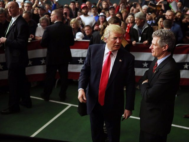 MILFORD, NH - FEBRUARY 02: Republican Presidential candidate Donald Trump speaks with former Massachusetts senator Scott Brown after he had endorsed him for president during a campaign event at Hampshire Hills Athletic Club on February 2, 2016 in Milford, Iowa. Democratic and Republican Presidential are stumping for votes throughout New …
