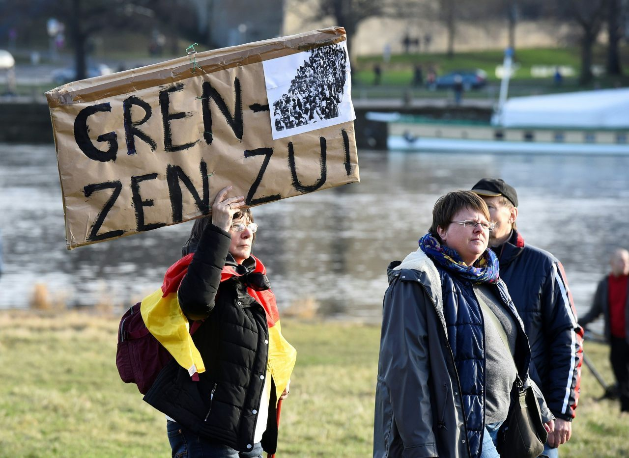"A demonstrator holds a placard reading ""Close the borders!"" (TOBIAS SCHWARZ/AFP/Getty Images)"