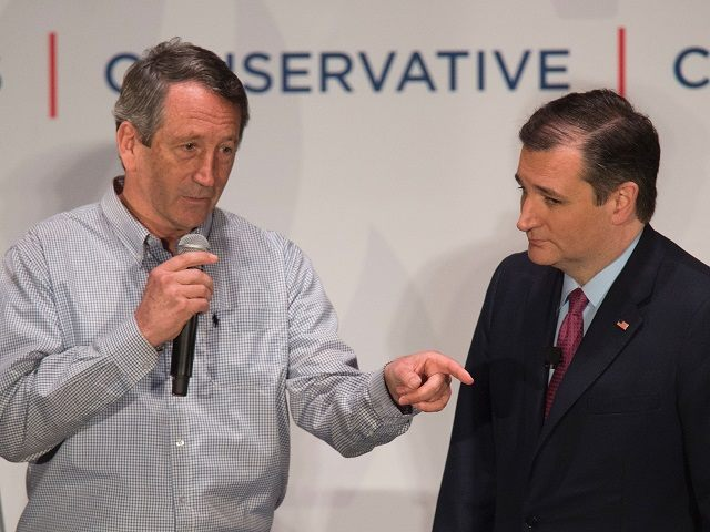 Republican presidential candidate Ted Cruz receives the endorsement of former South Carolina Governor and US Congressman Mark Sanford during a campaign rally in Charleston, South Carolina, February 19, 2016.  / AFP / JIM WATSON        (Photo credit should read JIM WATSON/AFP/Getty Images)