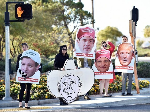 Supporters of Republican presidential candidate Donald Trump hold out signs at the entrance to Silverton Casino where candidate Marco Rubio held a campaign event in Las Vegas, Nevada on February 23, 2016. US Republican presidential candidates face off in Nevada February 23 as frontrunner Donald Trump tries to maintain momentum …