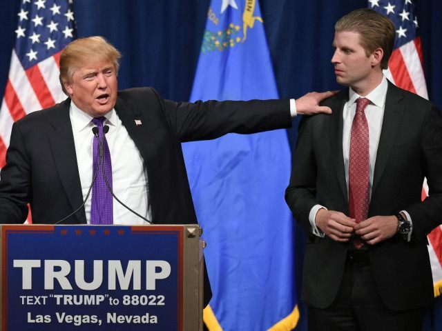 "LAS VEGAS, NV - FEBRUARY 23:  Republican presidential candidate Donald Trump (L) speaks as his son Eric Trump looks on during a caucus night watch party at the Treasure Island Hotel & Casino on February 23, 2016 in Las Vegas, Nevada. The New York businessman won his third state victory in a row in the ""first in the West"" caucuses.  (Photo by Ethan Miller/Getty Images)"