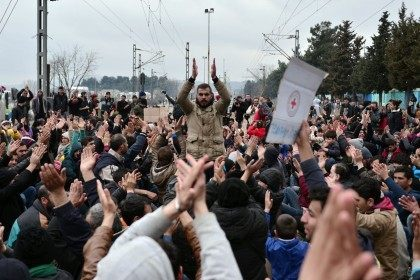Migrants mass on the Greek-Macedonian borders shouting 'open the border' as they block train tracks on February 28, 2016. - LOUISA GOULIAMAKI/AFP/Getty