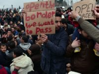 Syrian and Iraqi refugees trapped at the Greek-Macedonian border protest demanding the opening of the borders on February 28, 2016. More than 5,000 people were trapped at the Idomeni camp after four Balkan countries announced a daily cap on migrant arrivals. Slovenia and Croatia, both EU members, and Serbia and …