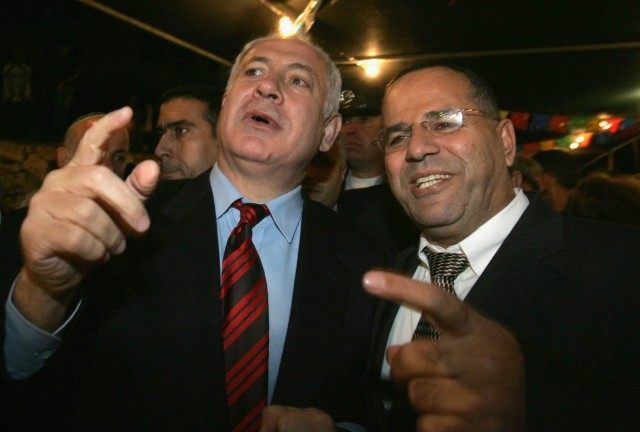 Likud party leader Benjamin Netanyahu (L) is greeted by his host and party colleague Ayoub Kara, as he attends an Israeli Druze celebration December 27, 2005 in the northern Israeli Druze town of Daliat al Carmel.