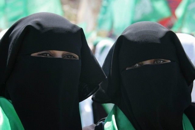 Palestinian students and supporters of the Hamas movement campaign for the student council elections at the Hebron University in the West Bank city of Hebron on May 6, 2008.