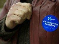 A woman displays her Hillary Clinton sticker at a Democratic Party Caucus at Jackson Township Fire Station on February 1, 2016 in Keokuk, Iowa. Ted Cruz felled long-time Republican frontrunner Donald Trump and Democrat Hillary Clinton was battled into a virtual tie with rival Bernie Sanders, as Iowans held the inaugural vote of the 2016 White House race. / AFP / Michael B. Thomas (Photo credit should read