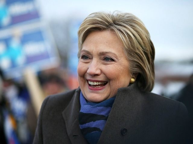 NASHUA, NH - FEBRUARY 09: Democratic presidential candidate former Secretary of State Hillary Clinton greets voters outside of a polling station at Fairgrounds Junior High School on February 9, 2016 in Nashua, New Hampshire. New Hampshire voters are heading to the polls in the nation's first primaries. (Photo by )