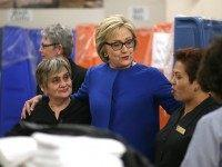 Democratic presidential candidate former Secretary of State Hillary Clinton (C) meets with service workers at Caesars Palace Las Vegas Hotel and Casino on February 18, 2016 in Las Vegas, Nevada.