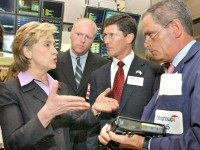 U.S. Sen. Hillary Rodham Clinton, D-NY, left, U.S. Rep Joe Crowley, D-NY, second left, New York Stock Exchange chief executive John Thain, and NYSE trader Robert Keenan, right, discuss electronic trading on the NYSE trading floor, Tuesday Aug. 3, 2004.  In a filing made Monday with the U.S. Securities and Exchange Commission, the NYSE said it wants to give stock traders the option to have their trades executed electronically, no matter the price or number of shares involved, while still providing the option for a floor-based auction run by specialists that the exchange says often results in price improvement for both parties. (AP Photo/Richard Drew)