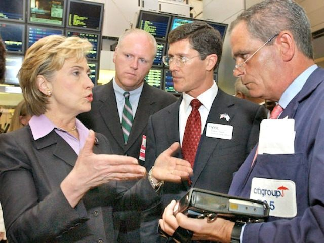 U.S. Sen. Hillary Rodham Clinton, D-NY, left, U.S. Rep Joe Crowley, D-NY, second left, New York Stock Exchange chief executive John Thain, and NYSE trader Robert Keenan, right, discuss electronic trading on the NYSE trading floor, Tuesday Aug. 3, 2004. In a filing made Monday with the U.S. Securities and …