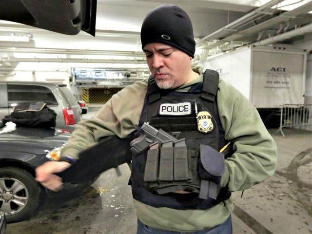 ICE Officer Tacs Up Richard Drew AP