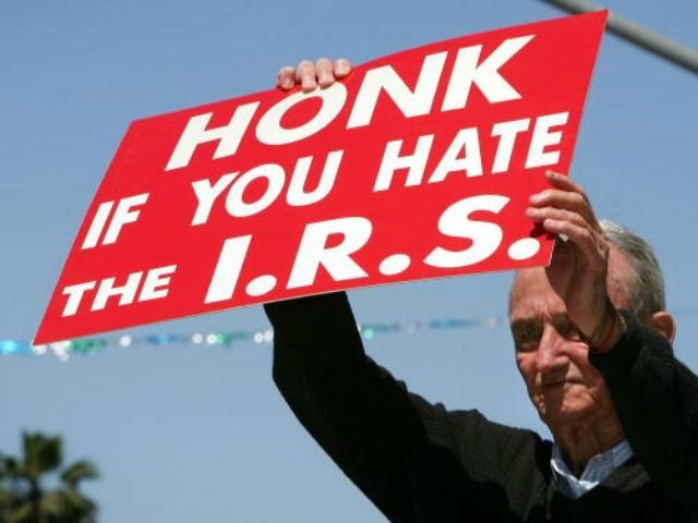 J. D. Montgomery holds a sign on the street outside of the James C. Corman Federal Building encouraging motorist to express their anger at the Internal Revenue Service (IRS) on their final day to file 2005 income taxes on April 17, 2006 in Van Nuys, California. Montgomery says he has …