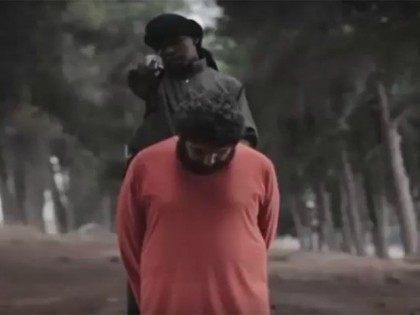 PHOTOS: Islamic State Video Shows Child Soldier Beheading Man