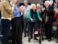 People stand and applaud as Republican presidential candidate, former Florida Gov. Jeb Bush arrives with his mother Barbara Bush to a town hall meeting at West Running Brook Middle School in Derry, N.H., Thursday Feb. 4, 2016. (AP Photo/Jacquelyn Martin)