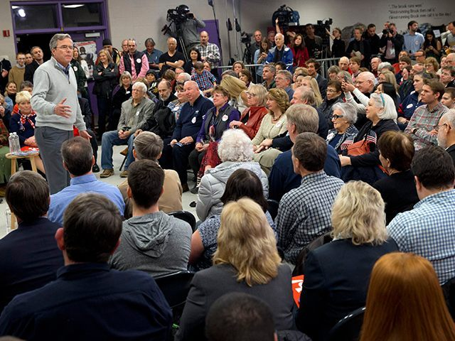 Republican presidential candidate, former Florida Gov. Jeb Bush, speaks to a packed room at a town hall meeting with his mother Barbara Bush at West Running Brook Middle School in Derry, N.H., Thursday Feb. 4, 2016. (AP Photo/Jacquelyn Martin)