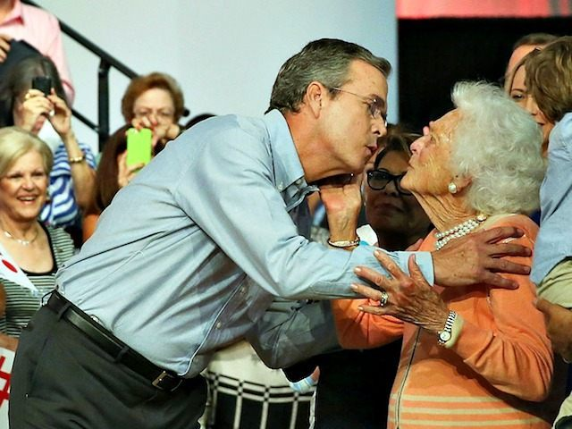 MIAMI, FL - JUNE 15: Former Florida Governor Jeb Bush kisses his mother Barbara Bush as he is introduced to announce his candidacy for the Republican presidential nomination during an event at Miami-Dade College - Kendall Campus on June 15 , 2015 in Miami, Florida. Bush joins a list of …