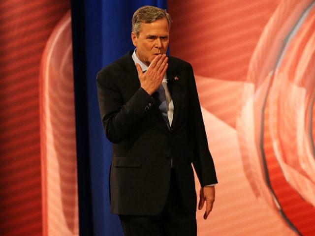 Republican presidential candidate Jeb Bush blows a kiss to his mother as he walks onstage at a CNN South Carolina Republican Presidential Town Hall with host Anderson Cooper on February 18, 2016 in Columbia, South Carolina. The primary vote in South )
