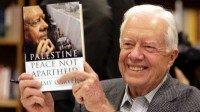 Jimmy Carter Holds book AP