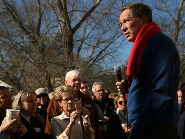Ohio Governor and Republican presidential candidate John Kasich speaks to voters outside of a restaurant in South Carolina following his second place showing in the New Hampshire primary on February 11, 2016 in Pawleys Island, South Carolina.