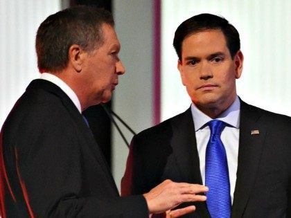 Republican presidential candidate, Ohio Gov. John Kasich , left, speaks with Republican presidential candidate, Sen. Marco Rubio, R-Fla., during the Fox Business Network Republican presidential debate at the North Charleston Coliseum, Thursday, Jan. 14, 2016, in North Charleston, S.C. (