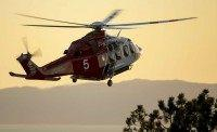 LAFD helicopter (Damian Dovarganes / Associated Press)