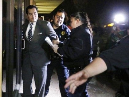 In this photo taken on Tuesday, Feb. 16, 2016, Crystal City Mayor Ricardo Lopez is taken away from city hall by police, in Crystal City, Texas, after allegedly disrupting a City Council meeting while fighting a recall effort that began before his indictment this month in a public corruption investigation …