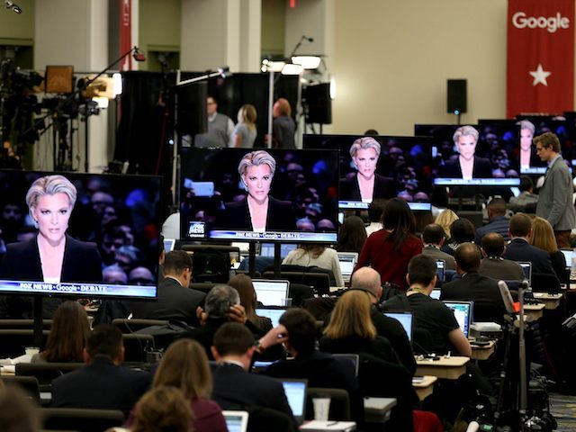 DES MOINES, IA - JANUARY 28: Fox News anchor and debate moderator Megyn Kelly is seen on television screens as she asks questions to Republican Presidential candidates as reporters watch the Republican Presidential debate sponsored by Fox News and Google at the Iowa Events Center on January 28, 2016 in …